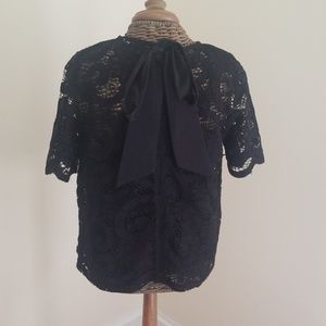 Black lace, bow in back, short sleeved box top